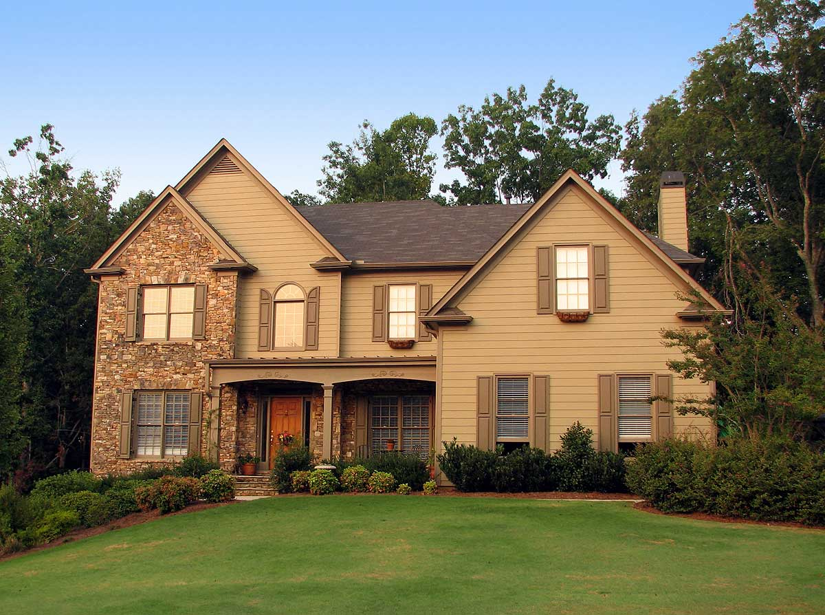 Traditional House Plan With 2-Story Grand Room