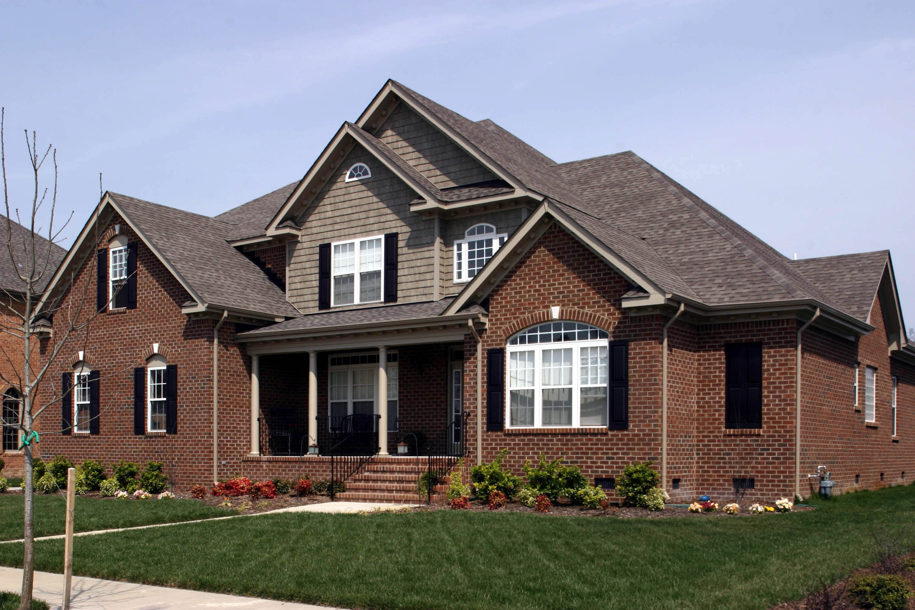 Traditional Home Plan With Brick Exterior