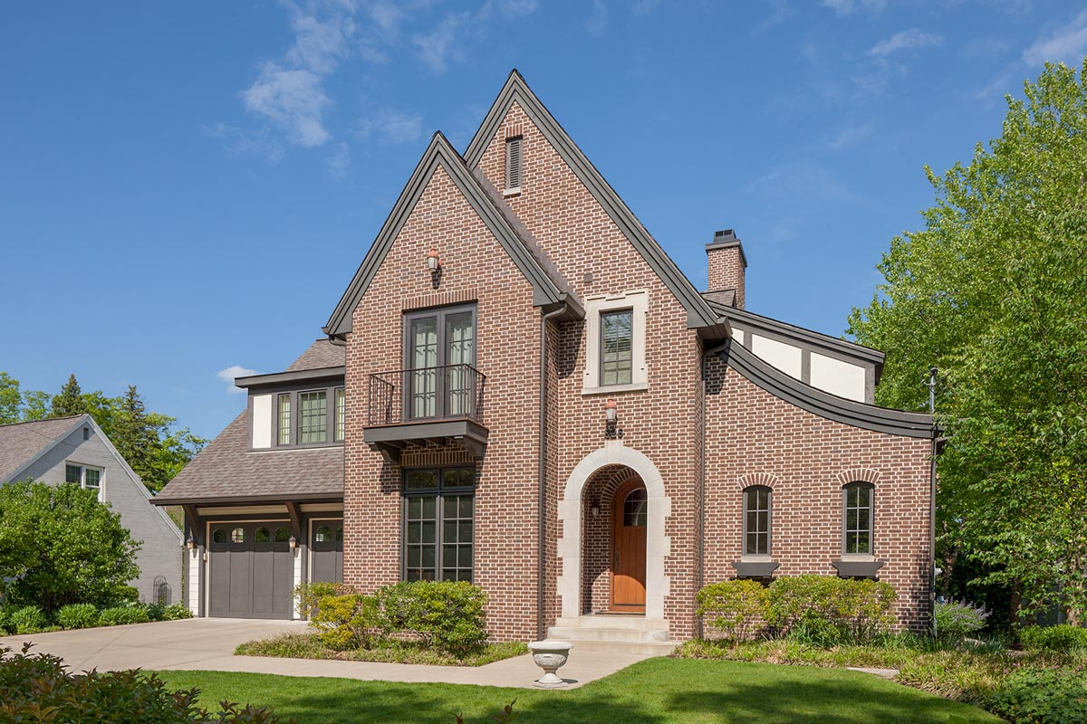 Elegant Tudor House Plan with Upstairs Loft and Bedroom
