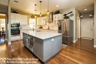 House Plan 4122WM comes to life in Texas again with an expanded garage! - photo 020