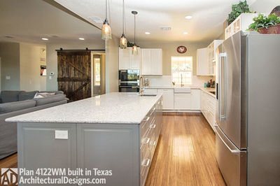House Plan 4122WM comes to life in Texas again with an expanded garage! - photo 021